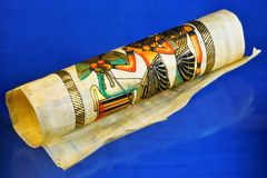 Papyrus scroll - Egyptian ancient scientific illustrated document. Papyrus scroll - Egyptian ancient document. Papyrus scroll - writing material, wound in a royalty free stock images