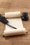 Papyrus scroll with inkwell. Papyrus scroll with quill pen and inkwell Stock Photography