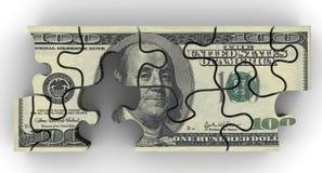Paquet de billets de banque des USA sous forme de puzzle Images stock