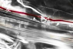 Paquet de fermeture éclair avec le macro rouge de rayure photos libres de droits