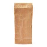 Paquet de papier brun de métier pour le thé ou le café d'isolement au-dessus du fond blanc Photographie stock libre de droits