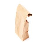 Paquet de papier brun de métier pour le thé ou le café d'isolement au-dessus du fond blanc Photos libres de droits