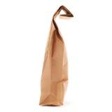 Paquet de papier brun de métier pour le thé ou le café d'isolement au-dessus du fond blanc Images stock