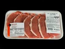 Paquet de porc de maigre de Publix sur un contexte noir photographie stock libre de droits