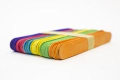 Paquete aislado de palillos coloridos del helado Imagen de archivo libre de regalías