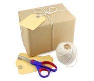 Paquete con necesidades del embalaje Fotografía de archivo