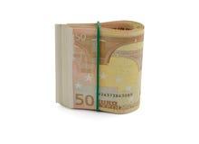 Paquete de billetes de banco euro con el elástico aislado en el backgrou blanco Fotografía de archivo libre de regalías