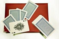 Paquete en un cuaderno rojo Imagen de archivo libre de regalías