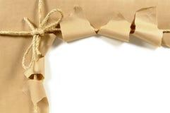 Paquete marrón rasgado Imagen de archivo libre de regalías