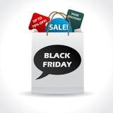 Paquete negro del descuento de viernes Fotografía de archivo libre de regalías
