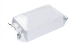Paquete plástico en blanco Imagen de archivo