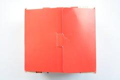 Paquete rojo de la caja del abrigo Foto de archivo libre de regalías