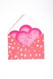 Paquete rosado con el regalo para la tarjeta del día de San Valentín Fotos de archivo libres de regalías
