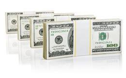 Paquetes con el dinero de los dólares Imágenes de archivo libres de regalías