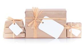 Paquetes de Brown con la escritura de la etiqueta en blanco Foto de archivo libre de regalías