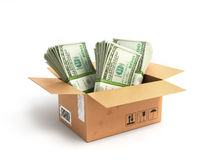 Paquetes de los dólares del dinero en una caja fotografía de archivo libre de regalías