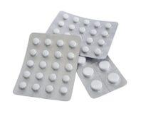 Paquetes de píldoras aisladas en el fondo blanco Imágenes de archivo libres de regalías