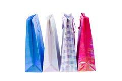 Paquets colorés pour des achats sur un fond blanc Photographie stock
