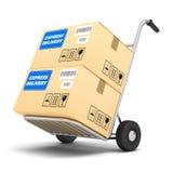 Paquets de la livraison express sur un chariot Photographie stock libre de droits