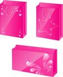 Paquets de papier roses avec la conception de charme Photographie stock libre de droits