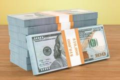 Paquets du dollar sur la table en bois 3d Photographie stock libre de droits