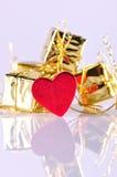 Paquets et coeur de cadeau Photographie stock libre de droits
