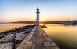 Paquis Lighthouse at Sunrise, Geneva Royalty Free Stock Image