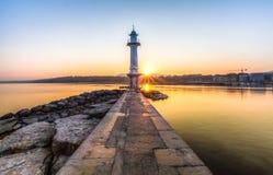 Paquis Lighthouse at Sunrise, Geneva. View of the lighthouse at Bains des Paquis and lake Geneva at sunrise Royalty Free Stock Image