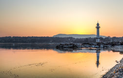 Paquis Lighthouse at Sunrise, Geneva. View of the lighthouse at Bains des Paquis and lake Geneva at sunrise Stock Photo