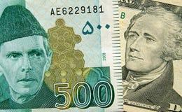 Paquistán y billetes de banco de los E.E.U.U. Foto de archivo libre de regalías