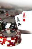Pair of aces in front of poker chips Stock Photography