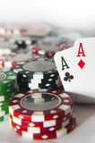 Pair of aces in front of poker chips Royalty Free Stock Image
