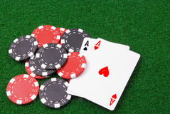 Par of aces and some poker chips. A par of aces and some poker chips on green table Stock Images