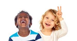 Par av barn som gör skämt Fotografering för Bildbyråer