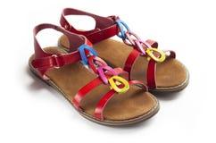 Par av färgrika kvinnliga sandaler Royaltyfri Fotografi