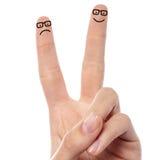 Par av fingrar med skissad smiley Fotografering för Bildbyråer