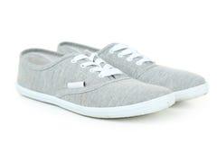 Par av gråa skor Fotografering för Bildbyråer