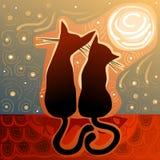 Par av katter som är förälskade på ett hustak Arkivbild