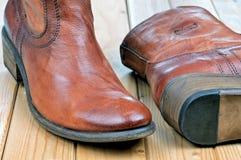 Par av klassiska kängor för läderbruntcowboy Royaltyfri Fotografi