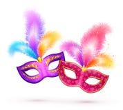 Par av ljusa karnevalmaskeringar med färgrikt Fotografering för Bildbyråer