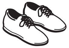 Par av skor Arkivfoton