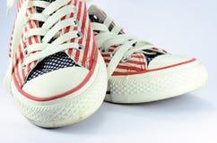 Par av skor med amerikansk stjärnor och bandgarnering Royaltyfria Foton