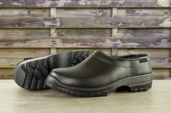 Par av svart av skor Arkivfoto
