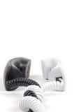 Par av telefonmottagare svart white Royaltyfri Bild