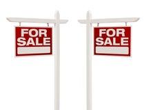 Par av till salu Real Estate tecken med den snabba banan Royaltyfri Fotografi