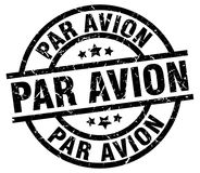 Par avion stamp. Par avion round grunge stamp isolated on white background Royalty Free Stock Photo