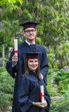 Par i avläggande av examendagen Fotografering för Bildbyråer