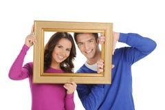 Par i ram. fotografering för bildbyråer
