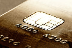 Par la carte de crédit d'or photos stock