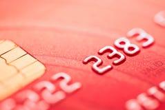 Par la carte de crédit rouge Image libre de droits